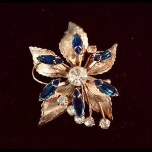 Vintage GF brooch with blue and clear stones.